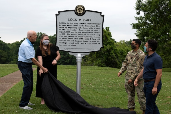 Jeff Syracuse, Metro Council member for District 15; Jessica Reeves, who oversees the historic markers program with the Metro Historical Commission; Lt. Col. Sonny Avichal, U.S. Army Corps of Engineers Nashville District commander; Bill Holman, grandson of former lockmaster Red Holman, unveil a historical marker during a ceremony at Lock 2 Park, highlighting the historical relevance of Lock and Dam 2. (USACE photo by Lee Roberts)
