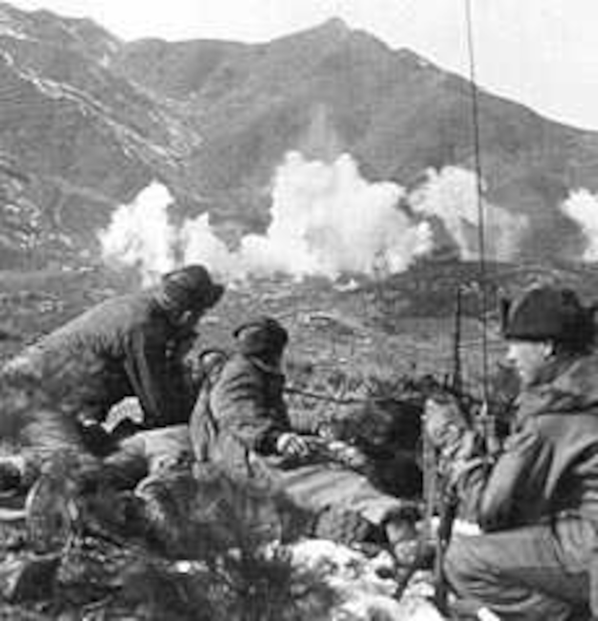 Soldiers call artillery fire onto enemy position.