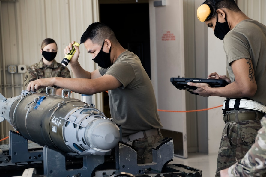 Airmen from the 432nd Aircraft Maintenance Squadron compete in a Load Crew of the Quarter competition, at Creech Air Force Base.