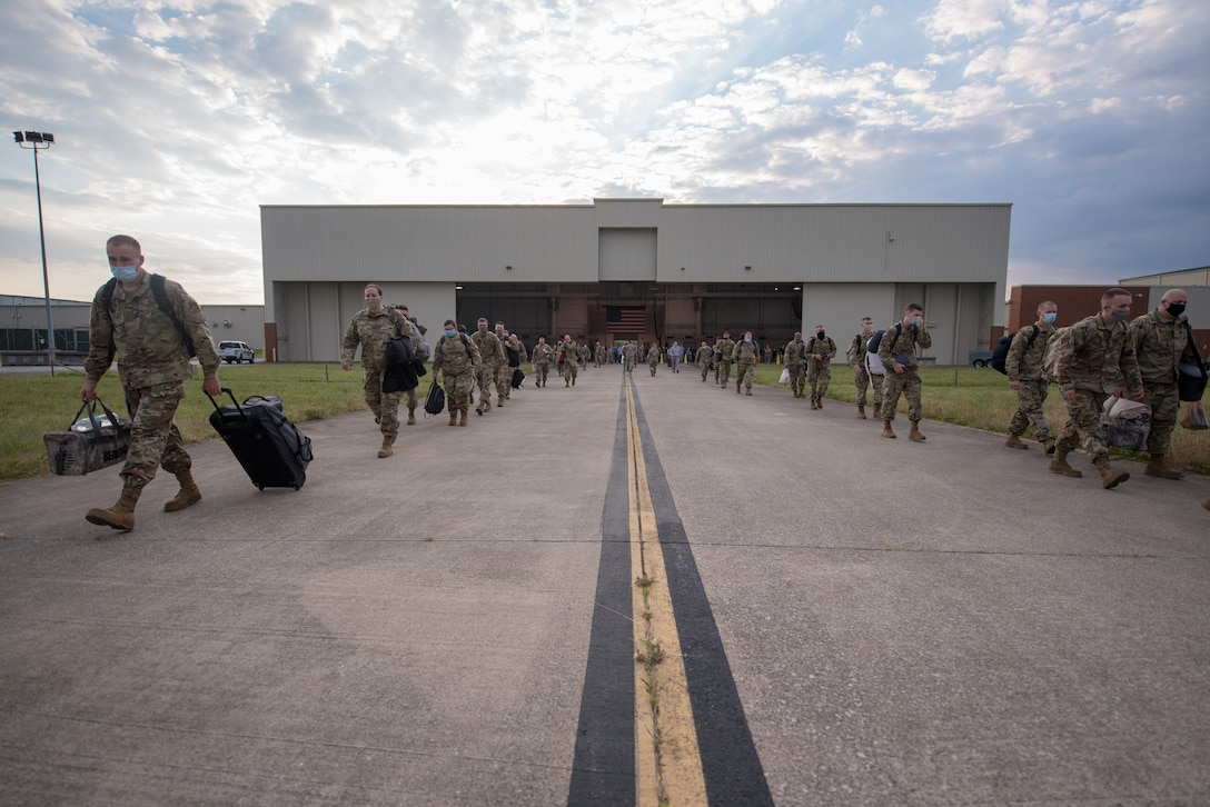Members of the 123rd Airlift Wing board a C-130 Hercules aircraft at the Kentucky Air National Guard Base in Louisville, Ky., June 24, 2020, prior to deploying to the Persian Gulf region. The Airmen will spend four months flying troops and cargo across the U.S. Central Command area of responsibility, which includes Iraq, Afghanistan and northern Africa. (U.S. Air National Guard photo by Senior Airman Clayton Wear)