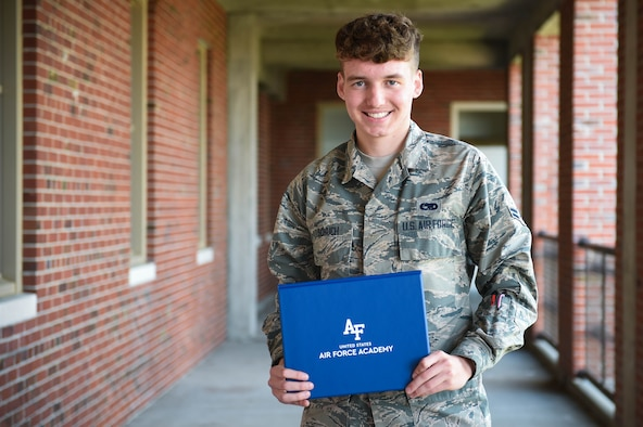 Airman 1st Class Chad Schuch, 62nd Aircraft Maintenance Squadron crew chief, holds his acceptance certificate to the U.S. Air Force Academy (AFA) Preparatory School in Colorado Springs, Colo., at Joint Base Lewis-McChord, Wash., June 19, 2020. The AFA accepts about 1,000 students per year, with 170 spots available for prior enlisted applicants. (U.S. Air Force photo by Airman 1st Class Mikayla Heineck)