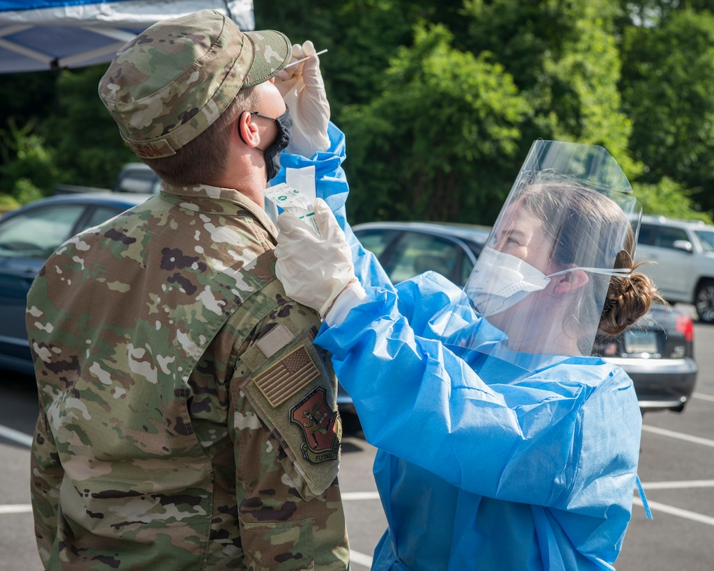 U.S. Air Force Staff Sgt. Carley Dolan, 103rd Medical Group aerospace medical technician, tests a 103rd Airlift Wing Airman for COVID-19 at Bradley Air National Guard Base, East Granby, Connecticut, June 19, 2020. The 103rd Medical Group worked in partnership with the Connecticut National Guard 14th Civil Support Team, New York National Guard 24th Civil Support Team, and Connecticut Department of Public Health to provide COVID-19 testing to Connecticut Air National Guard personnel. (U.S. Air National Guard photo by Staff Sgt. Steven Tucker)