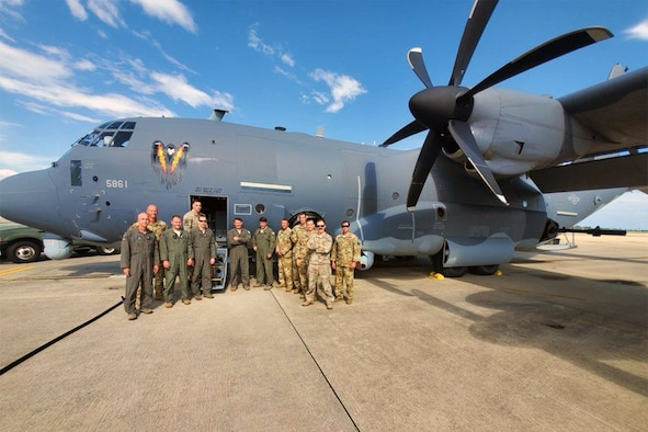 A group of 5th Special Operations Squadron Airmen pose in front of a AC-130J, June 5, 2020, Hurlburt Field, Fla.