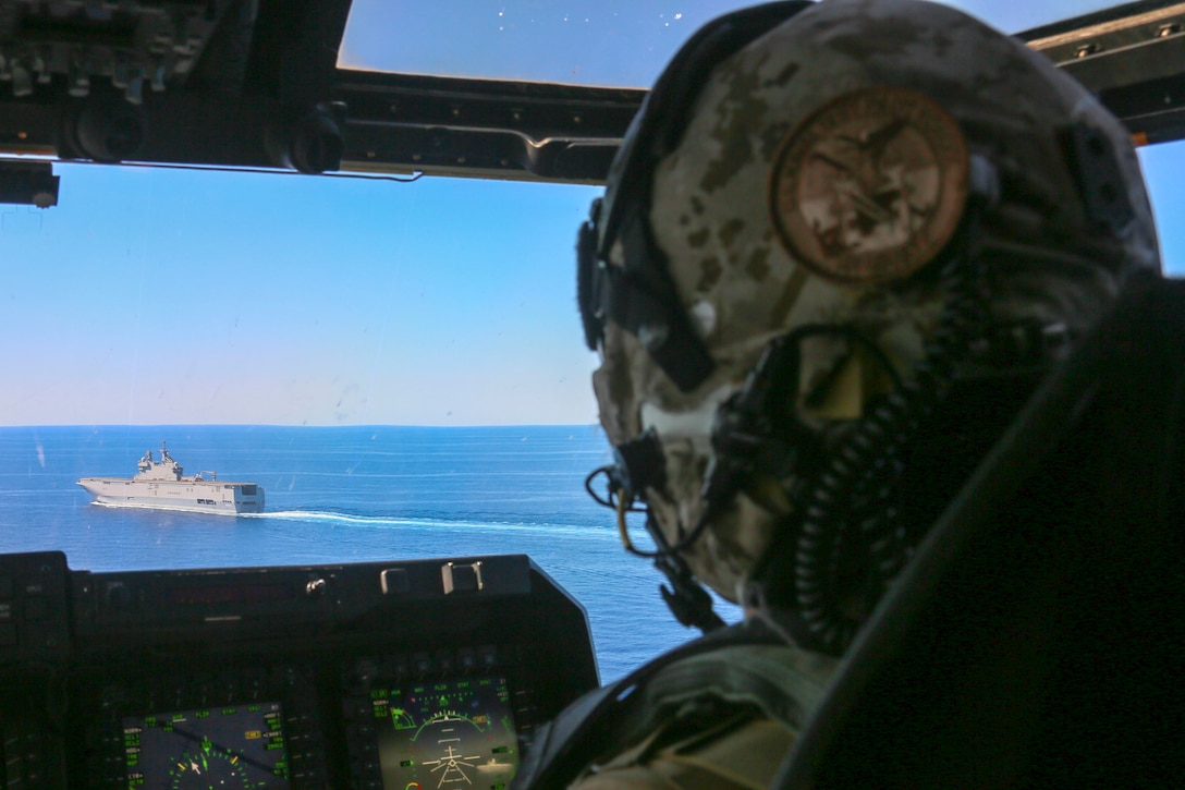 A U.S. Marine prepares to land aboard the French Navy amphibious assault ship Mistral June 24.