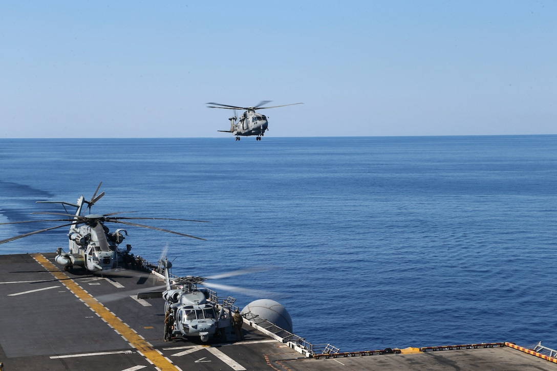 An Italian SH-101A medium-lift helicopter prepares to land aboard the amphibious assault ship USS Bataan during deck landing qualifications June 24.