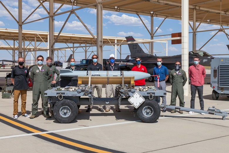 Members from the Gray Wolf test team and 416th Flight Test Squadron, pose for a photo following a captive-carry flight test of the Gray Wolf cruise missile prototype at Edwards Air Force Base, California, June 9. (Air Force photo by Kyle Brazier)