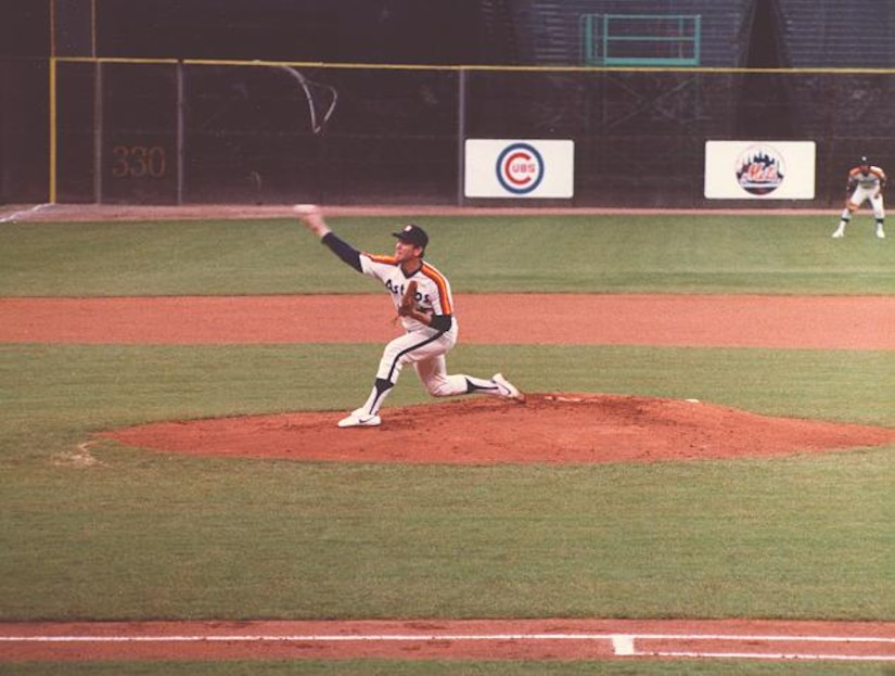 A pitcher throws a ball.
