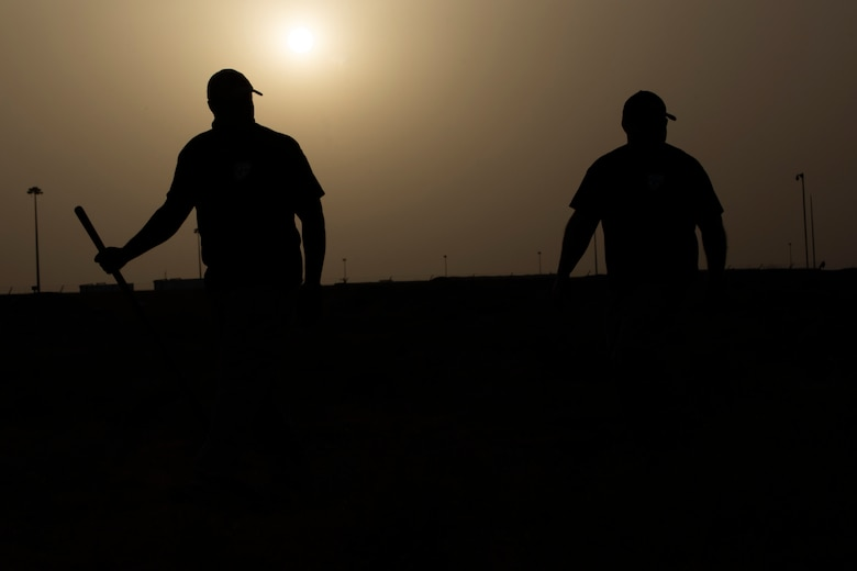 MWD handlers walk away after planting simulated IEDs
