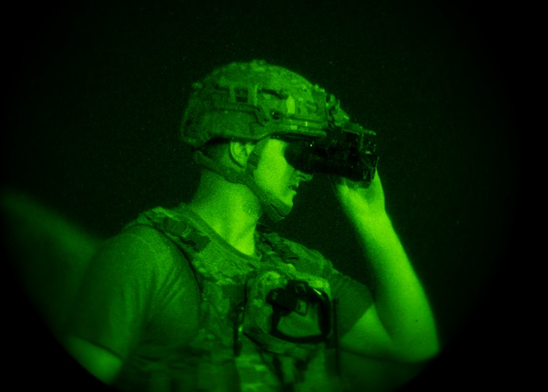 EOD Airmen adjusts his night vision goggles