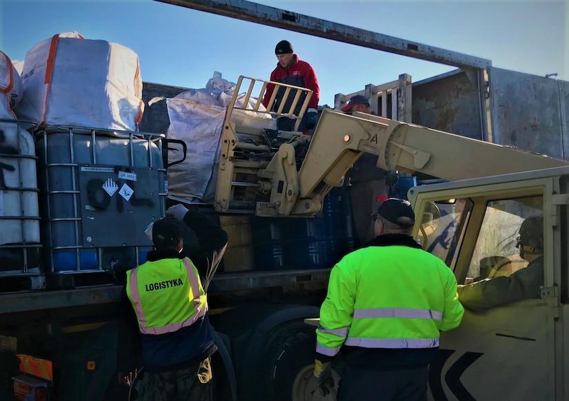 Hazardous waste is loaded onto a truck.