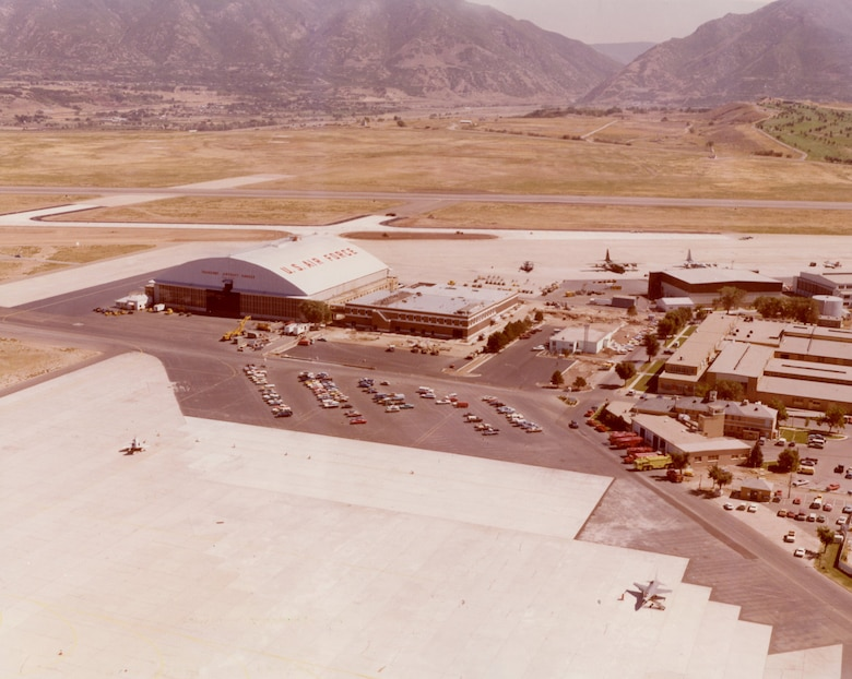 Aerial view of Hill AFB's Transient Aircraft Hangar (Building 1) and flight line aprons, from the west looking east, c. 1979.