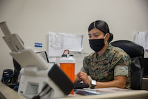 U.S. Marine Corps LCpl. Vanessa HernandezLopez, an administrative specialist with Installation Personnel Admin Center (IPAC), Marine Corps Air Station (MCAS) Yuma, inputs information on the computer during her daily routine on MCAS Yuma, June 10, 2020. IPAC handles all administrative services to all Marines and their family members assigned to MCAS Yuma. (U.S. Marine Corps photo by Lance Cpl John Hall)