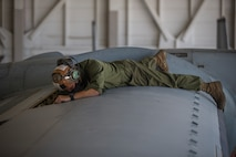 U.S. Marines Corps Cpl Reid Ellis Jr, a MV-22 tiltrotor mechanic with Marine Operational Test and Evaluation Squadron (VMX) 1, conducts routine maintenance on a MV-22 Osprey on Marine Corps Air Station (MCAS) Yuma, June 18, 2020. VMX-1 is an operational test squadron that tests multiple aircraft, allowing the continuation of improving the safety, reliability, and lethality of Marine Corps aircraft. (U.S. Marine Corps photo by Lance Cpl John Hall)