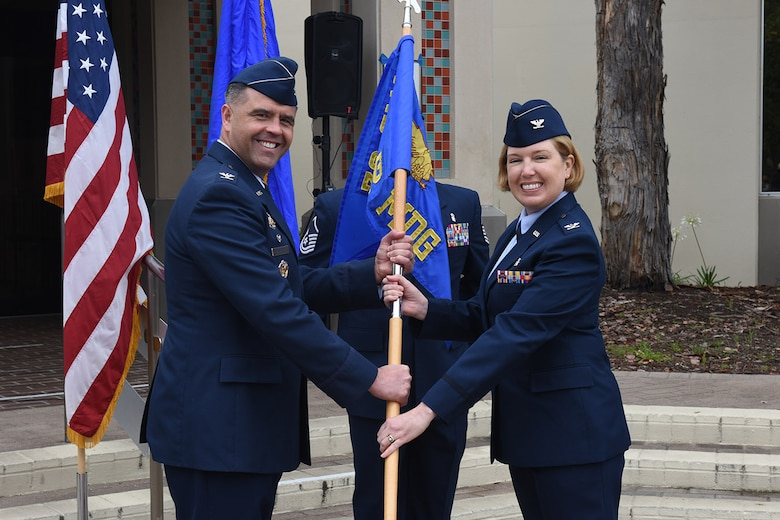 Photo of Colonel Mastalir and Colonel Spitler holding 30th Medical Group guidon