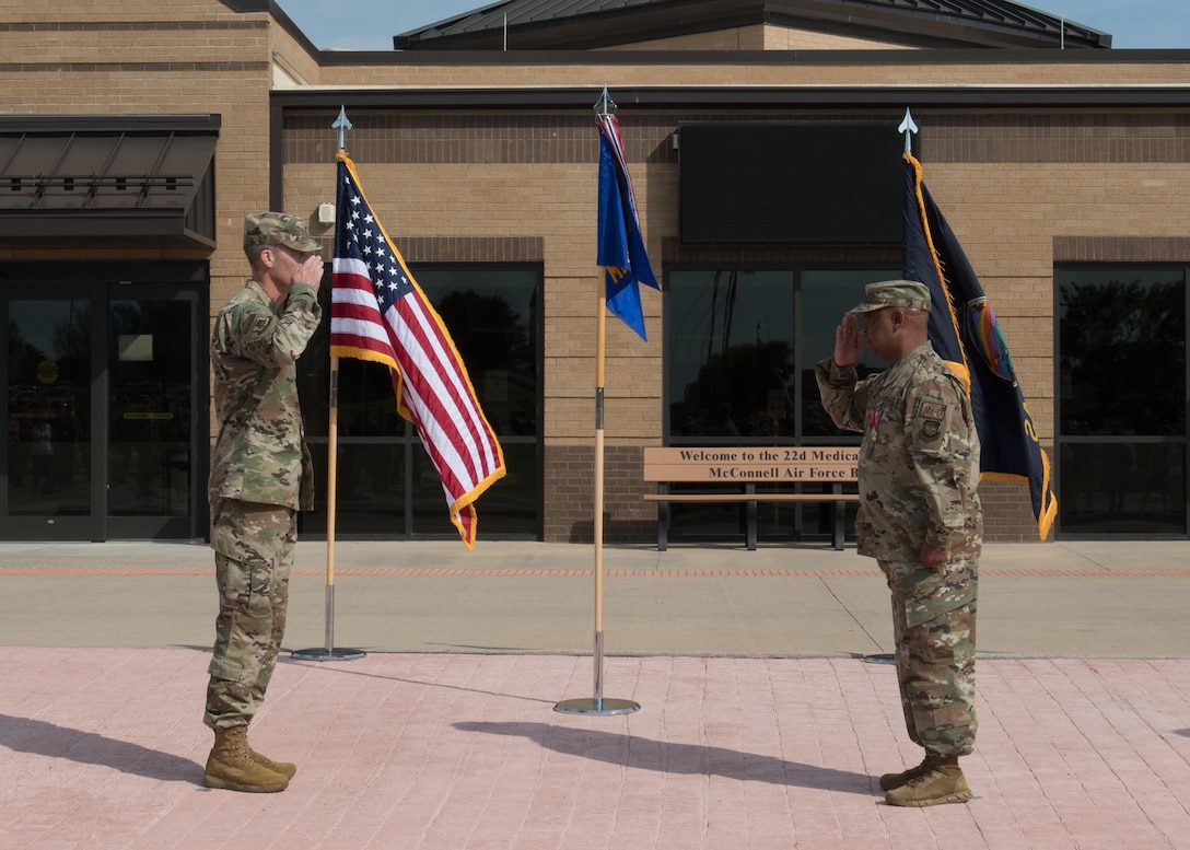 Col. Thomas Williford, 22nd Medical Group commander, right, relinquishes command of the 22nd Medical Group to Col. Richard Tanner, 22nd Air Refueling Wing commander, during a change of command ceremony June 25, 2020, at McConnell Air Force Base, Kansas. Williford was awarded the Legion of Merit for exceptionally meritorious conduct in the performance of outstanding services and achievements. (U.S. Air Force photo by Tech. Sgt. Jennifer Stai)