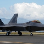 A F-22 Falcon tactical aircraft sits on the flightline on Joint Base Pearl Harbor-Hickam, Hawaii, Apr. 21, 2020. The F-22 has been around since 2005, helping maintain air dominance through impressive stealth, agility, and tactical aptitude.
