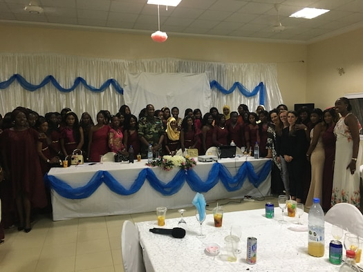 Members of the 818th Mobility Support Advisory Squadron and Senegalese Air Force pose for a photo at the Women's Military Integration Dinner Debate in Senegal, Africa, March 7, 2020.  The event was held in honor of International Women's Day and included discussions on opportunities and challenges associated with advancing the participation of and opportunities for women in the Senegalese Air Force.