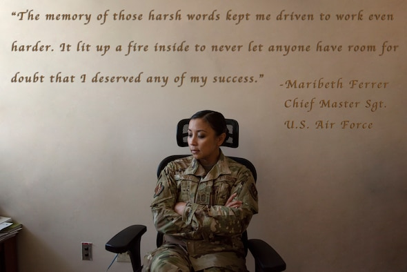 U.S. Air Force Chief Master Sgt. Maribeth Ferrer, 39th Medical Group Superintendent, poses for a photo in her office June 22, 2020, at Incirlik Air Base, Turkey. Ferrer faced discrimination as a woman of color in the early stages of her Air Force career, and now fights to create a culture where all Airmen feel safe and welcome. (U.S. Air Force illustration by Staff Sgt. Joshua Magbanua)