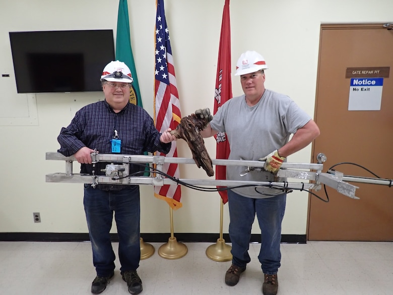 Jay Haugen and Kreg Buryta with their orifice debris plunger device after a successful test on May 5, 2020.