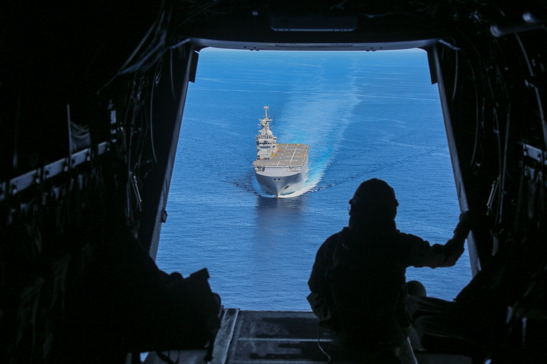 A U.S. Marine observes the French Navy amphibious assault ship Mistral June 24.
