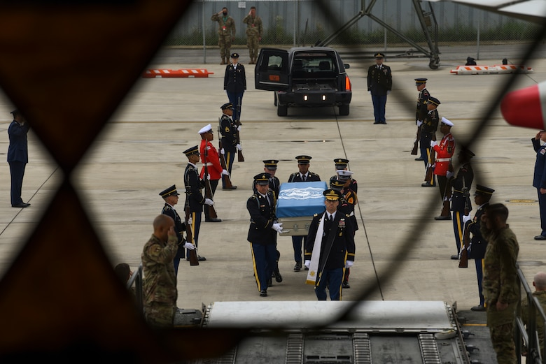 UNC Honor Guard carry transfer case to aircraft