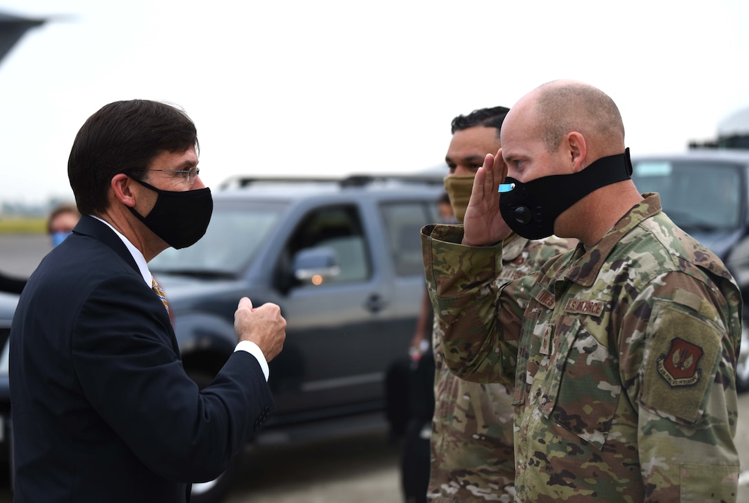 Chief Master Sgt. Douglas Vines, 100th Civil Engineer Squadron career enlisted manager, salutes U.S. Secretary of Defense Dr. Mark T. Esper before his departure from RAF Mildenhall, England, June 26, 2020. Esper met with 100th ARW, 352nd Special Operations Wing, Royal Air Force and tenant unit leadership to learn of the various mission sets and discuss the base's role in operations in both the European and African theaters. (U.S. Air Force photo by Brandon Esau)