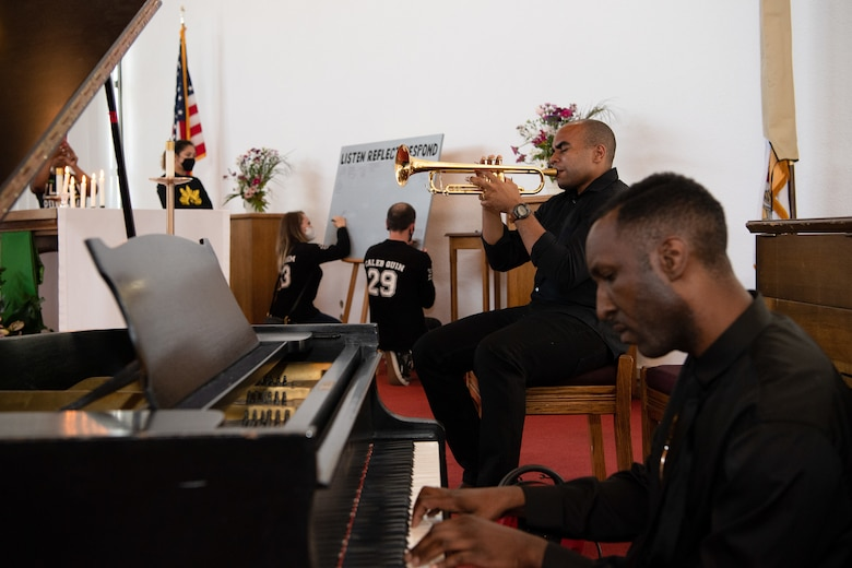U.S. Army Sgt. 1st Class Christian William, U.S. Army Europe Band and Chorus platoon sergeant, and Spc. Willie Reed, USAREUR Band and Chorus pianist, play music during the Juneteenth: Vigil for Healing event at Ramstein Air Base, Germany, June 19, 2020.