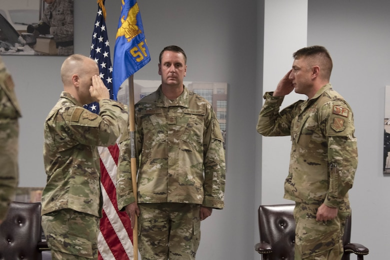 Lt. Col. Jason E. Stack salutes Col. Joseph A. Engelbrech III to assume command of the 316th Security Forces Squadron during a change of command ceremony at Joint Base Andrews, Md., June 24, 2020.