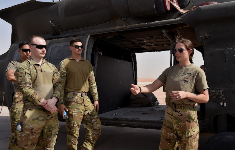 Members of the 378th Expeditionary Civil Engineering Squadron Fire Department receive familiarization training from members of Task Force Javelin at Prince Sultan Air Base, Kingdom of Saudi Arabia, June 25, 2020. The crucial training enables the 378th ECES to work seamlessly with members of TFJ to load critically injure or ill patients for Med-Evac, quickening the loading of patients while maintaining a safe environment for responders.