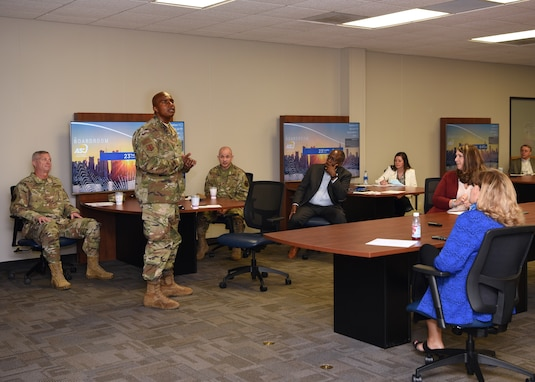 U.S. Air Force Col. James Finlayson, 17th Training Wing vice commander, introduces himself to local community members during a cybersecurity, community partnership conference at Angelo State University's Rassman building, in San Angelo, Texas, June 23, 2020. To combat COVID-19, ASU restricted the briefing room occupancy, required attendees to wear masks, and sanitized the classroom surfaces prior to the event. (U.S. Air Force photo by Airman 1st Class Abbey Rieves)