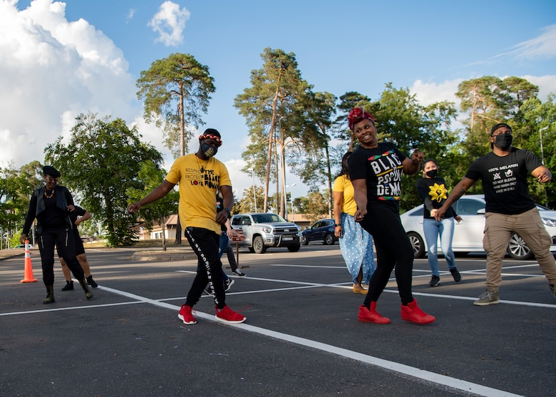 Kaiserslautern Military Community members perform a dance in celebration of Juneteenth at Ramstein Air Base, Germany, June 19, 2020.