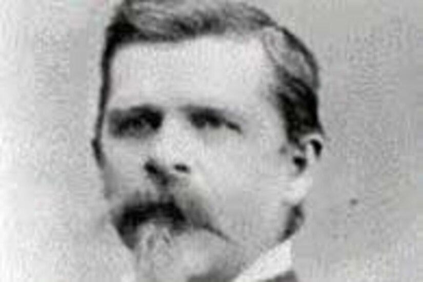 A bearded man poses in a Civil War-era uniform.