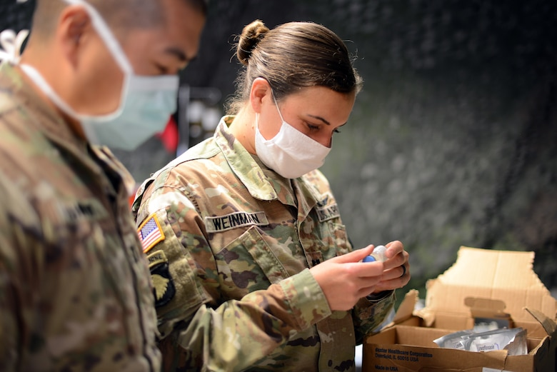 U.S. Army Capt. Jessica Weinman, 67th Forward Resuscitative Surgical Team Emergency Nurse, reviews the medication stock and prepares commonly used medications for an inbound patient prior to a training scenario at the Medical Simulation Training Center, Ramstein Air Base, June 19, 2020.