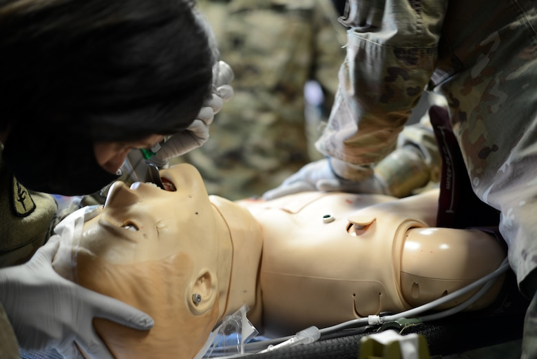 U.S. Army Capt. Jennifer Hensel, 67th Forward Resuscitative Surgical Team Nurse Anesthetist, intubates a patient during a training scenario at the Medical Simulation Training Center, Ramstein Air Base, June 19, 2020.