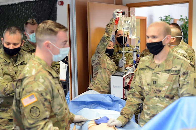 U.S. Army Spec. Alexandra Jimenez, 67th Forward Resuscitative Surgical Team licensed practical nurse hangs notional blood on the Belmont Rapid Infuser during a training scenario at the Medical Simulation Training Center, Ramstein Air Base, June 19, 2020.