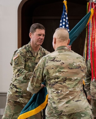 Maj. Gen. Daniel G. Mitchell, incoming commanding general of ASC, receives the flag during a change of command ceremony held June 24.