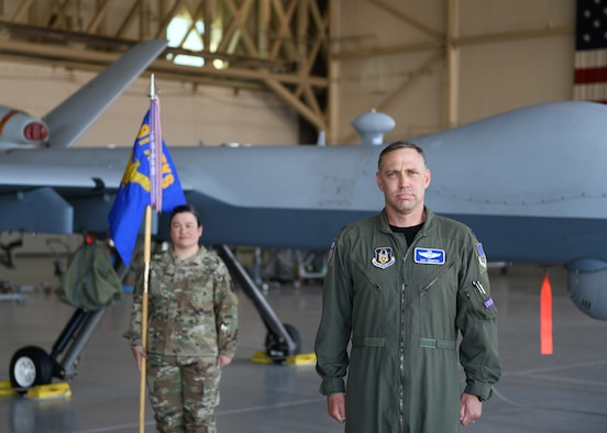 Lt. Col. Arthur A. Thompson accepts command of the 91st Attack Squadron, June 19, 2020, Creech Air Force Base, Nevada. The Change of Command ceremony was modified to honor the heritage of the passing of the wing guidon while maintaining current social distancing guidelines. (U.S. Air Force photo by Natalie Stanley)