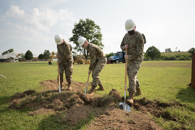 Brig. Gen. Hal Lamberton (left), adjutant general for the Commonwealth of Kentucky, Brig. Gen. Jeffrey Wilkinson (center), assistant adjutant general for Air, Kentucky Air National Guard, and Col. Dave Mounkes, commander of the 123rd Airlift Wing, break ground for a new $8.9 million Response Forces Facility at the Kentucky Air National Guard Base in Louisville, Ky., June 26, 2020. The 28,000-square-foot, two-story structure will house the Contingency Response Group, Security Forces Squadron, base honor guard and a medical detachment for the state's CBRNE Enhanced Response Force Package. (U.S. Air National Guard photo by Phil Speck)