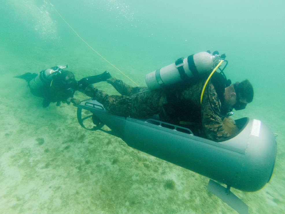 U.S. Marines complete an open circuit dive during a Diver Propulsion Device certification course at Camp Schwab, Okinawa, Japan, June 23.