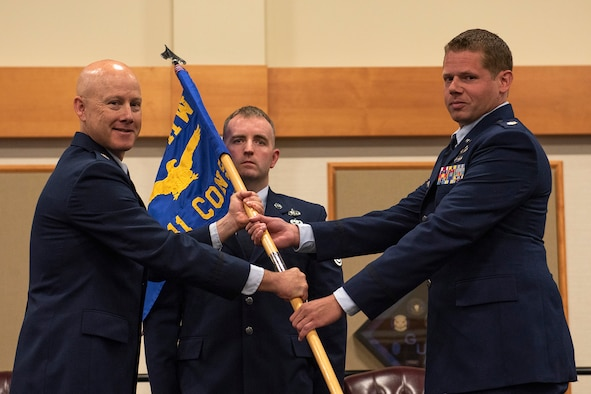 Maj. Matthew Bublitz, right, accepts command of the 341st Contracting Squadron from Lt. Col. Jonathan Lawson, 341st Mission Support Group deputy commander, during a change of command ceremony June 25, 2020, at Malmstrom Air Force Base, Mont.