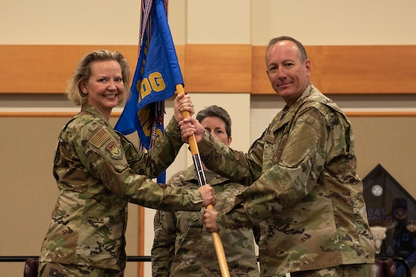 Col. Mark Pomerinke, right, accepts command of the 341st Medical Group from Col. Jennifer Reeves, 341st Missile Wing commander, during a change of command ceremony June 26, 2020, at Malmstrom Air Force Base, Mont.