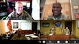Five Soldiers participate in a media round table via video chat with the screen split into four squares.