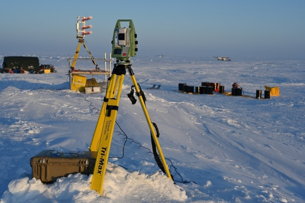 A Gamma Portable Radar Interferometer and a Robotic Laser Theodolite sit on top of a large pressure ridge near a U.S. Navy ice camp on the Beaufort Sea, March 4, 2020. The Gamma Portable Radar Interferometer continuously measures precise distances from itself to an array of reflectors deployed around the camp and runway. It is able to detect small movements of the reflectors in relation to each other, and can tell researchers how the ice is expanding and contracting. The radar interferometer in an alternate method to accomplish a similar goal, sending out radar pulses that reflect off of various ice surfaces and records the reflected signal.