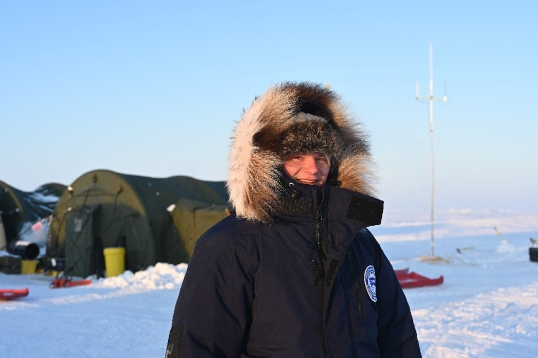 Dr. Nick Wright, a research physical scientist at the U.S. Army Engineer Research and Development Center's Cold Regions Research and Engineering Laboratory, takes a walk around the tent encampment at the U.S. Navy ice camp in the Beaufort Sea on a brisk evening, with calm winds and temperatures at -30 degrees Fahrenheit, March 4, 2020.
