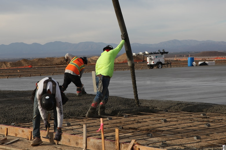 Concrete is poured, June 25, at the site of the future Air Force Flight Test Museum at Edwards Air Force, which will be located just outside of the  Base's West Gate. (Air Force photo by Grady Fontana)