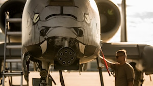 Aircraft maintenance crew chief performs a preflight inspection on an A-10C Thunderbolt II