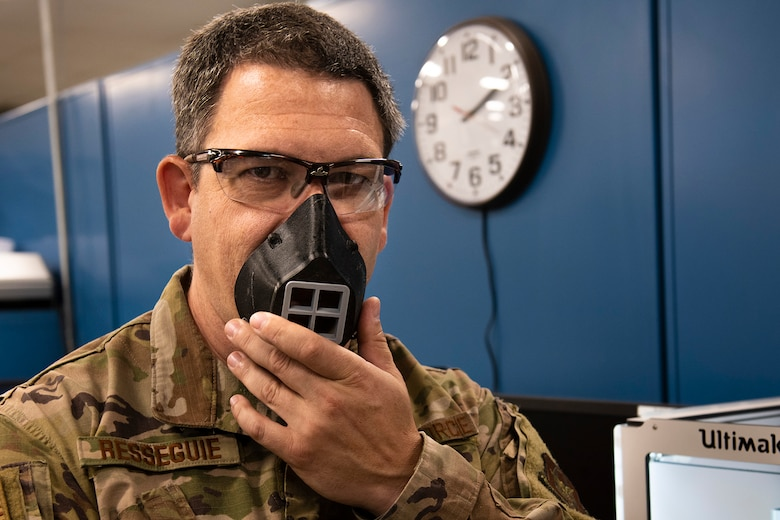 Tech. Sgt. Michael Resseguie, 919th Special Operations Maintenance Squadron metals technology craftsman, dons a 3D-printed face-covering created by the metals technology shop at Duke Field, Florida, June 23, 2020.