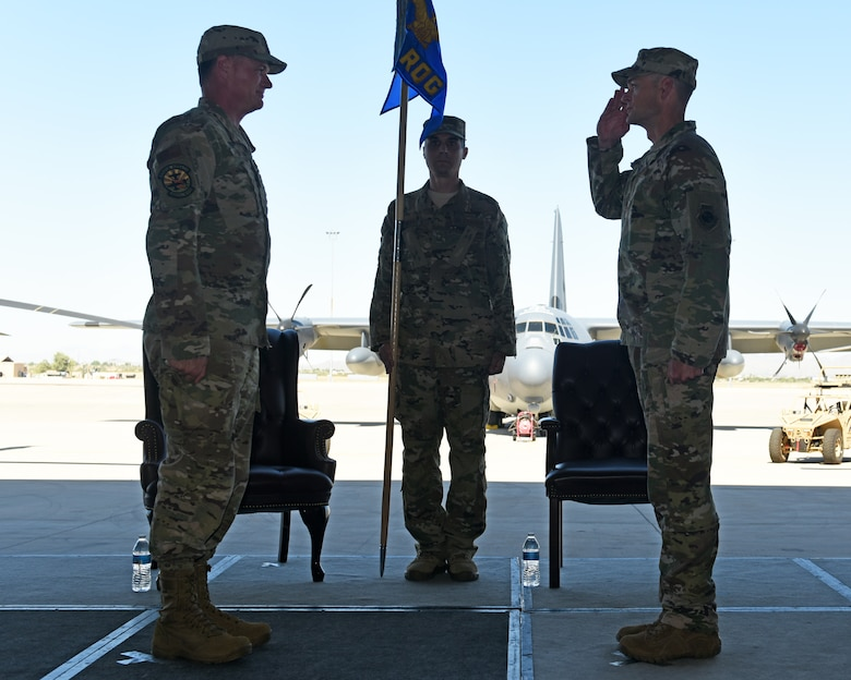 photo of a U.S. Air Force member saluting another during a change of command ceremony