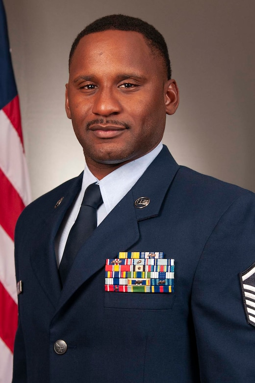 Carlos Jackson poses for a photo in his Air Force uniform.