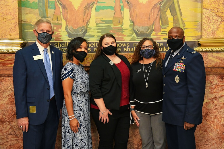 Dave Gruber (left), Aurora city councilmen, and Col. Devin Pepper, 460th Space Wing commander,poses with prominent Buckley Air Force Base spouses for a group photo at the Colorado State Capitol Building in Denver, June 25, 2020.